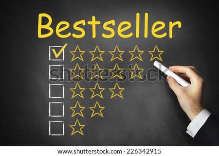 hand writing bestseller on black chalkboard golden rating stars