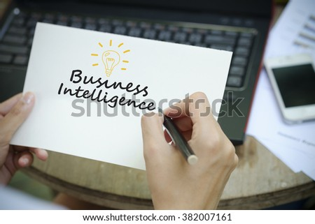 hand writing  business intelligence Plan concept on white notebook , business concept ,business intelligence concept  - stock photo