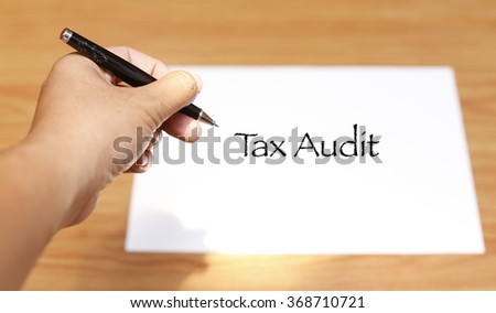 Hand writing Business Notes - Tax audit .soft focus , selective focus - stock photo