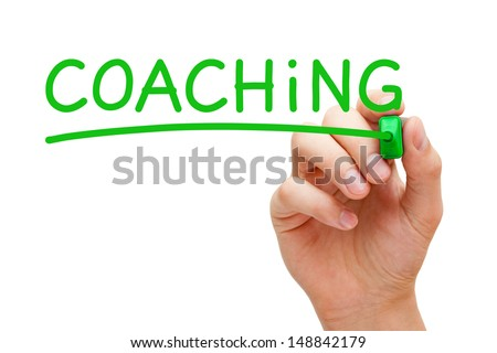 Hand writing Coaching with green marker on transparent wipe board. - stock photo
