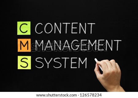 Hand writing Content Management System with white chalk on blackboard.