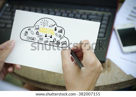 hand writing  creative marketing Plan concept on white notebook , marketing concept  - stock photo