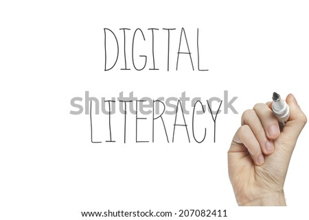 Hand writing digital literacy on a white board - stock photo