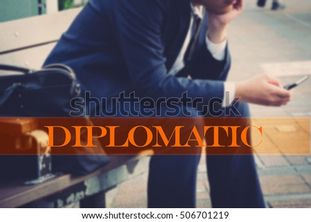 Hand writing diplomatic  with the abstract background. The word diplomatic   represent the action in business as concept in stock photo.