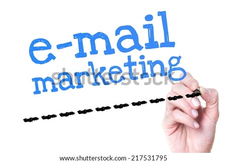 Hand writing E-mail Marketing with blue marker on transparent wipe board - stock photo