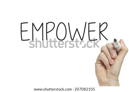 Hand writing empower on a white board - stock photo