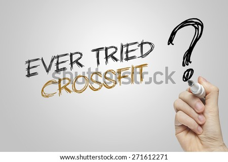 Hand writing ever tried crossfit on grey background - stock photo