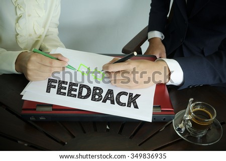 hand writing FEEDBACK text with two business person  , team work concept - stock photo