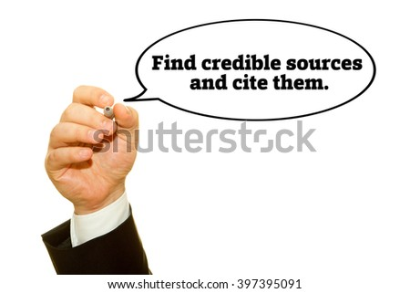 "Hand writing ""Find credible sources and cite them"". on a transparent wipe board."