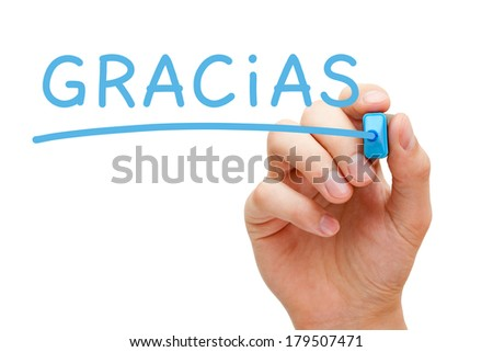 Hand writing Gracias with blue marker on transparent wipe board. - stock photo