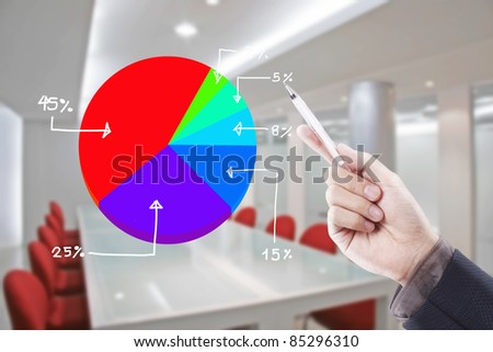 hand writing graph in conference room - stock photo