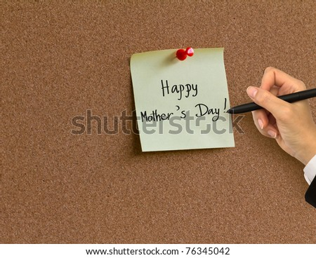 "Hand writing "" Happy Mother's Day "" in paper note on cork board background - stock photo"