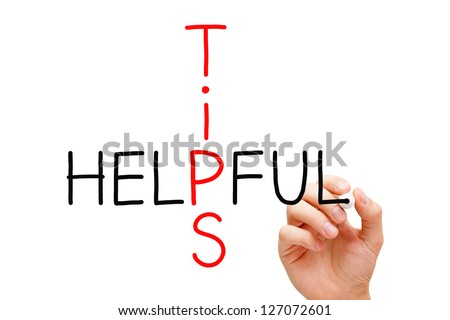 Hand writing Helpful Tips with black marker on transparent wipe board. - stock photo