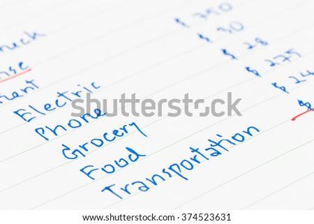 Hand writing home budget - stock photo