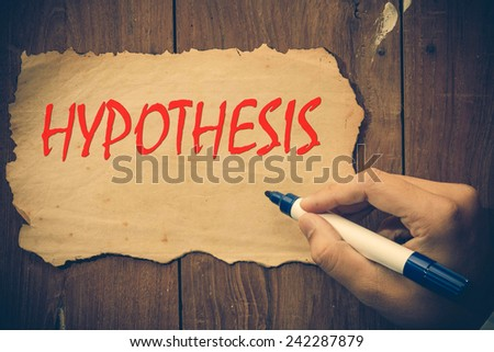 Hand writing hypothesis - stock photo