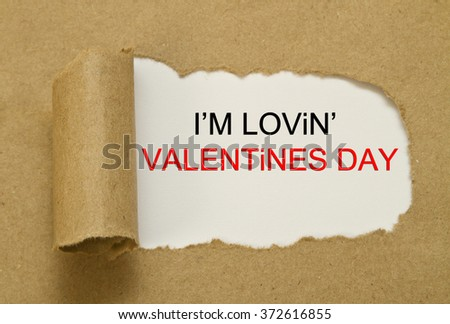 hand writing i am loving valentines day on a transparent wipe board - stock photo