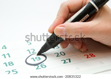 Hand writing important date - stock photo