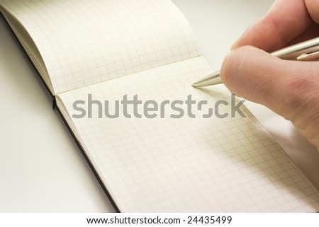 hand writing in a notebook - stock photo
