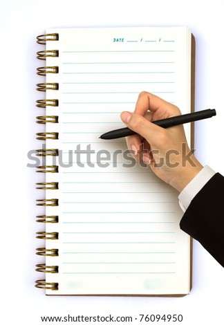 Hand writing in open notebook - stock photo