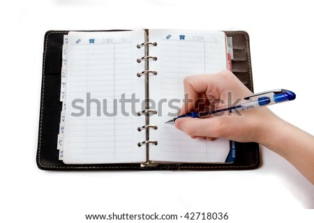 Hand writing in open notebook, isolated
