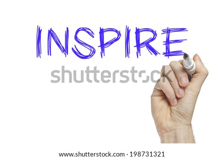 Hand writing inspire on a white board