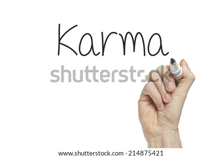 Hand writing karma on a white board