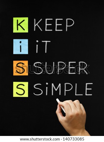 Hand writing Keep It Super Simple with white chalk on blackboard. - stock photo