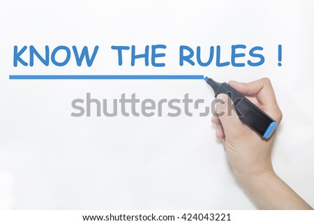 Hand writing know the rules with blue marker on transparent wipe board. - stock photo