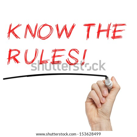 Hand writing Know The Rules with red marker on transparent wipe board - stock photo