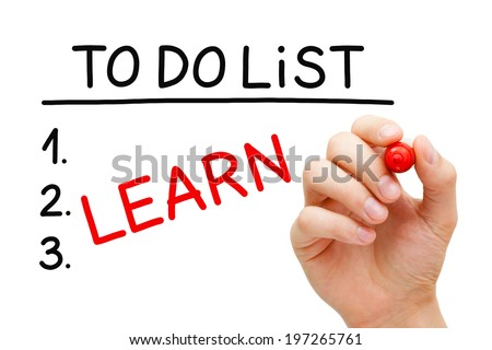 Hand writing Learn in To Do List with red marker isolated on white. - stock photo