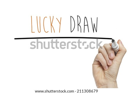 Hand writing lucky draw on a white board - stock photo