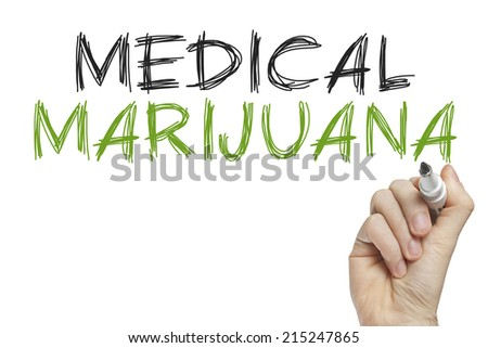 Hand writing medical marijuana on a white board - stock photo