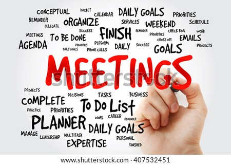 Hand writing MEETINGS word cloud, business concept background