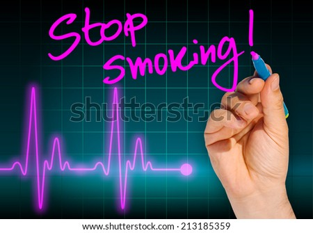 Hand writing message STOP SMOKING with heart rate monitor in the background expressing health hazard - Anti smoking campaign - stock photo