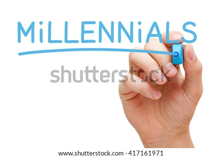 Hand writing Millennials with blue marker on transparent wipe board. Generation Y concept.