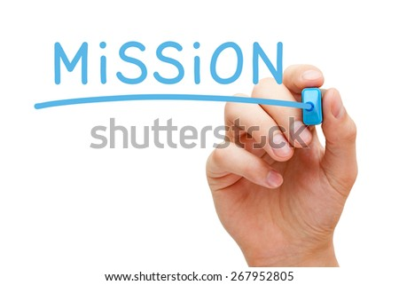 Hand writing Mission with blue marker on transparent wipe board. - stock photo