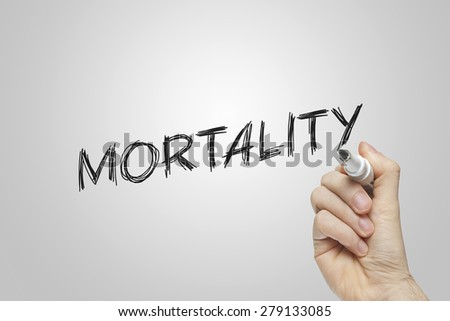 Hand writing mortality on grey background