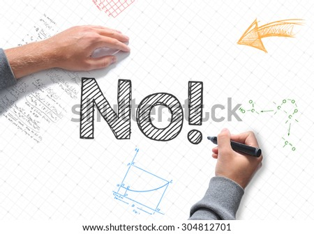 Hand writing No! on white sheet of paper - stock photo