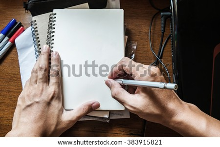 Hand writing notebook on working table, with copy space - stock photo
