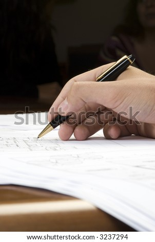 hand writing on a blueprint