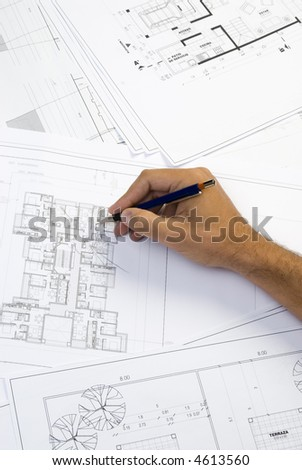 hand writing on a blueprint - stock photo