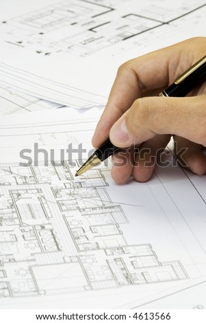 hand writing on a blueprint - stock photo