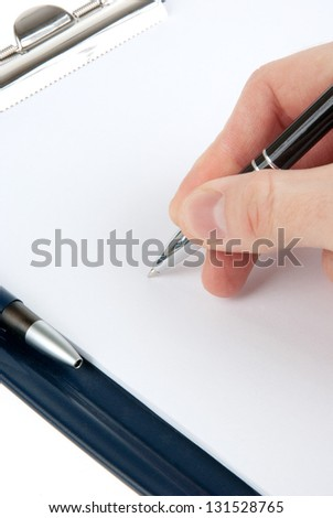 Hand writing on an empty document in a clipboard isolated on white background