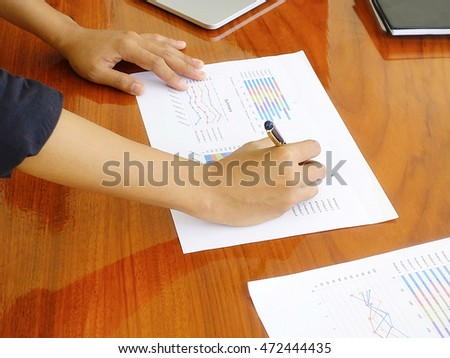 Hand writing on chart for strategy plan