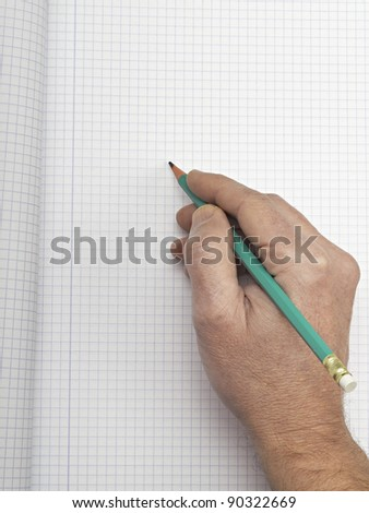 Hand writing on copy space. background of paper graph - stock photo