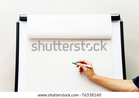 Hand writing on flip chart paper