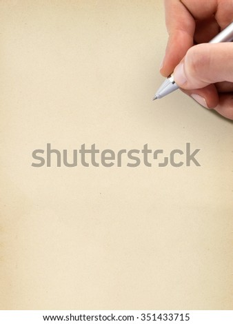 Hand writing on old grungy blank sheet of paper. - stock photo