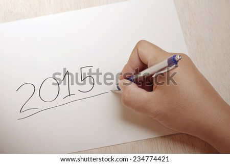 Hand writing 2015 on paper - stock photo