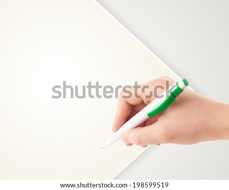 Hand writing on plain empty white paper copy space with pen - stock photo