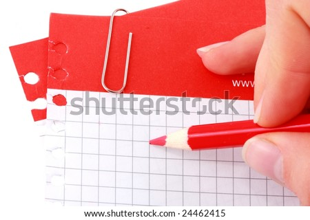 Hand writing on red strip notes with clip.